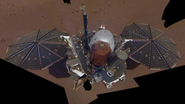 This composite image shows the InSight lander on the surface of Mars.