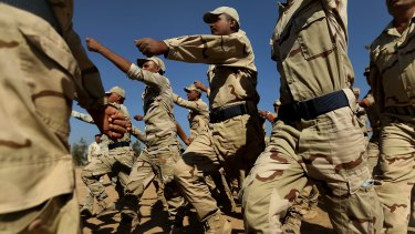 Iraq army recruits, pictured training in Baghdad, will benefit from a small increase in Australian involvement aimed at deterring Islamic State.