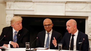 Donald Trump with Microsoft CEO Satya Nadella and Amazon boss Jeff Bezos.