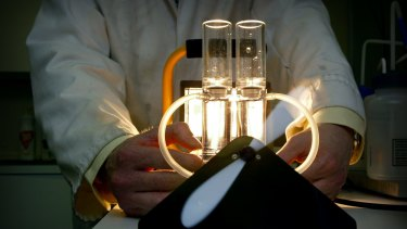 A scientist demonstrates technology that produces hydrogen fuel from solar power.