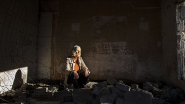 Six months after the fires Jann Gilbert sits in the ruins of her Mallacoota home.