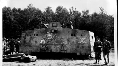 A German tank captured near Villers-Bretonneux,. The Germans had painted a German tank crushing a British lion. A British artist reversed the scene.