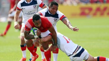 Fetu'u Vainikolo of Tonga is tackled by Brett Thomson of the USA during the World Rugby Pacific Nations Cup.