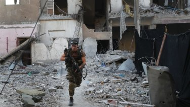 A US-backed Syrian Democratic Forces fighter during the battle to retake the former Islamic State capital of al-Raqqa in Syria.