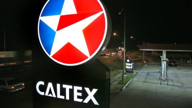 Caltex has had a bad six months due to sluggish consumer spending and falling refinery margins.