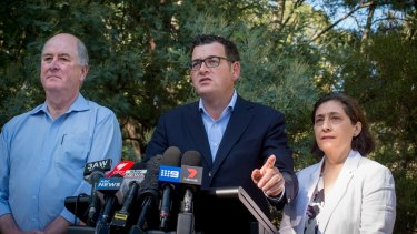 Premier Daniel Andrews, standing beside ministers responsible for energy safety and public housing, has been urged to act.