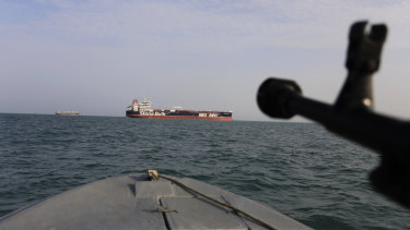 A speedboat of Iran's Revolutionary Guard trains a weapon toward the British-flagged oil tanker Stena Impero, which was seized in the Strait of Hormuz on July 19.