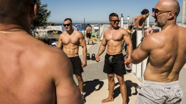 North Bondi's outdoor gym was busy with muscle-bound men flexing and posing on Saturday.