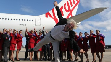 Richard Branson in happier times with Virgin Australia staff: The billionaire has snatched his UK airline Virgin Atlantic from the brink of collapse this week, but at a high personal cost.