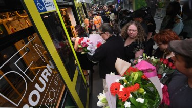 People carrying flowers boarded at each stop.
