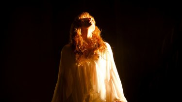 The self-described English ghost, Florence Welch, on stage with Florence + the Machine.