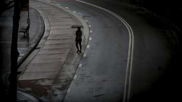 Umbrellas come out on the streets of Bondi Junction as light rain falls in Sydney.