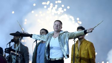 On song: Macklemore performs during the NRL grand final in 2017.