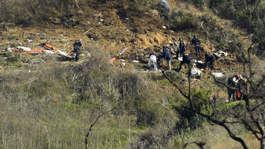 Investigators work the scene of a helicopter crash that killed former NBA basketball player Kobe Bryant, and his 13-year-old daughter, Gianna in Calabasas, California.