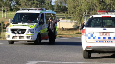 Police and paramedics in the aftermath of Senior Constable Brett Forte being shot.