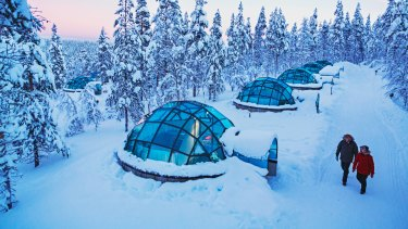 Glass igloos at Kakslauttanen Arctic Resort, Lapland, Finland.