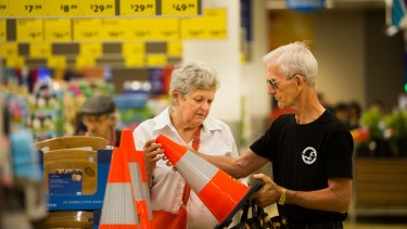 Shoppers Peter and Mary Ford inspecting traffic cones at Aldi.