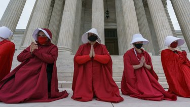 Activists opposed to Judge Barrett are dressed as characters from 'The Handmaid's Tale'.