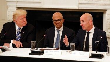 Butting heads: Donald Trump with Microsoft CEO Satya Nadella and Amazon boss Jeff Bezos.
