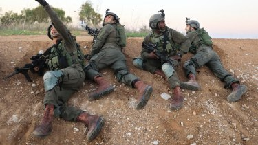 Israeli soldiers take cover near the Israel-Gaza border following a barrage of mortar and rocket fire that wounded six people in November.