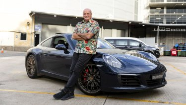 Paul with his Porsche that he allows  a player to drive as a reward for a good game.
