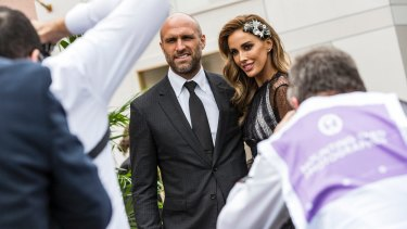 Perennial good pictorial sports, Chris and Rebecca Judd, on Derby Day.