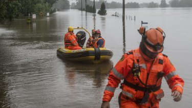 SES volunteers heading out to Ebenezer,   near Windsor, on a flooded Hawkesbury River.