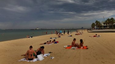 Beachgoers in St Kilda today.