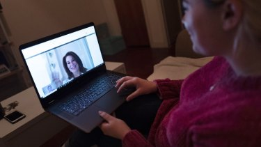 Why not for Australia's rural residents? A woman sits in her Brooklyn apartment in New York and has a telemedicine video conference with a physician.