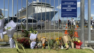 Makeshift memorial is seen in front of cruise ship Ovation of the Seas, in Tauranga, New Zealand on Tuesday.