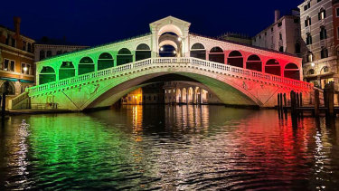 The Rialto Bridge in Venice is lit up in the colours of the Italian flag in honour of the medical workers on the COVID-19 frontlines. The city's economy has been hit hard by the pandemic.