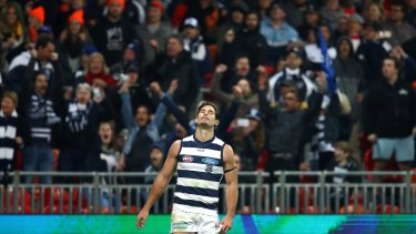 Tom Hawkins reacts after kicking a behind on the final siren to draw the match.