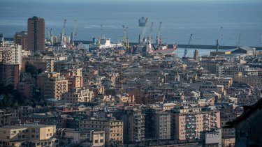 Container ships sit in the port at Genoa, Italy.