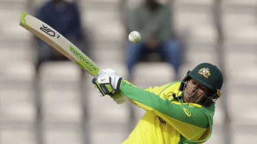 Khawaja hits a boundary during the World Cup warm-up match against Sri Lanka.