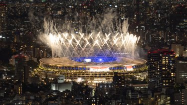Fireworks are let off over the Olympic Stadium during the closing ceremony of the Tokyo Olympics.
