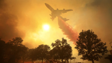 A 747 Global Airtanker makes a drop in front of advancing flames from a bushfire in Lakeport, California, on Thursday.