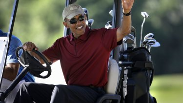 Trump criticised Obama for his frequent golfing. President Barack Obama waves from a golf cart in 2015.