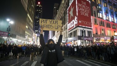 Protestors march in New York in 2014 following a grand jury's decision not to indict the police officer involved in the death of Eric Garner.