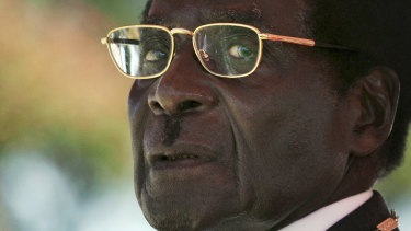 President Robert Mugabe waits to deliver a speech in 2008.