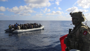 The conflict in Libya has forced thousands of people to flee in search of a better life in Europe. Here, migrants are picked up by the Turkish military on January 29 and returned to the Libyan Coast Guard.