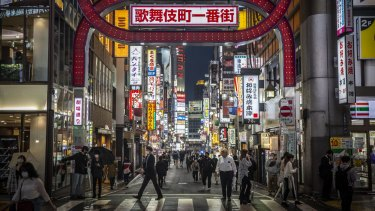 People wearing face masks in the Kabuki-cho area of Tokyo.