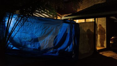 Police conduct a  raid on a Greenacre property on Tuesday.