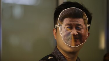 A protester wearing a mask depicting Chinese President Xi Jinping attends a protest in Hong Kong.