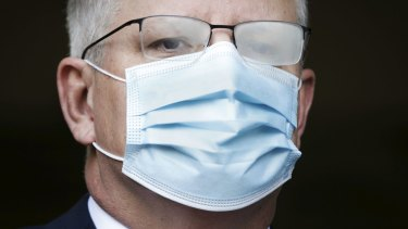 The Prime Minister dons his mask in Canberra in August.
