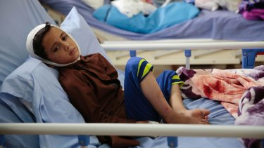 A child injured in a deadly Saudi-led coalition airstrike on on a school bus rests in a hospital in Saada, Yemen.