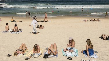 Beachgoers in NSW are being advised to keep a towel length apart.