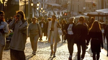 Muscovites stroll on a warm evening - most of them without face masks last month.