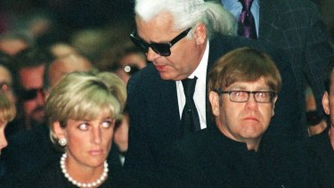 Diana, Princess of Wales, German fashion designer Karl Lagerfeld and British pop-star Elton John attend the memorial mass for Gianni Versace in Milan in 1997.