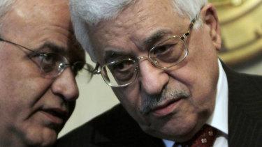 Whisperer: Saeb Erekat, left, talks to Palestinian President Mahmoud Abbas in 2008.