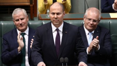 Treasurer Josh Frydenberg handing down last year's federal budget. A promised $7.1 billion surplus has been replaced with a near $84 billion deficit with even more red ink to come.